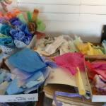 the studio with my palette of hand stained papers spread around me as I work.